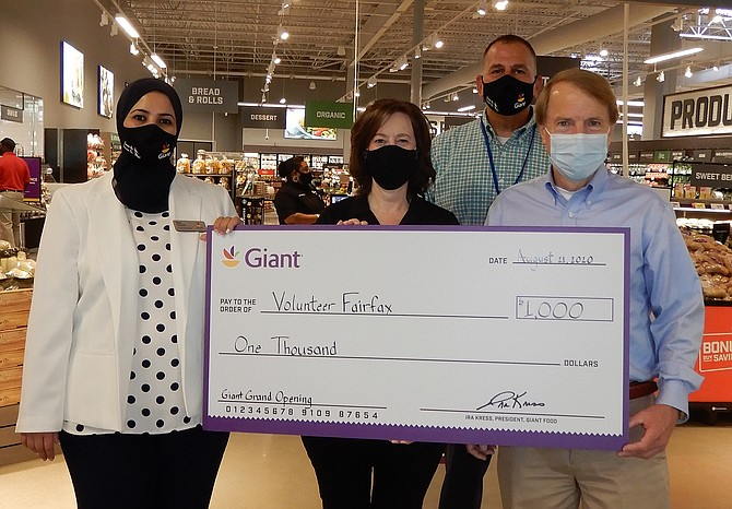 (From left) are Giant Store Manager Ilham Tarbouz, Volunteer Fairfax's Marianne Alicona, Giant District Manager Jeff Lewis and Mayor David Meyer.