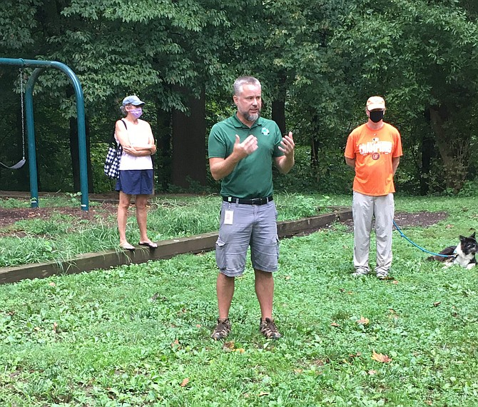 Bob Trumbull, manager of Montgomery Parks natural surface trail construction, addresses Cabin John residents concerned about changes in the Cabin John Stream Valley Park most used frequently.