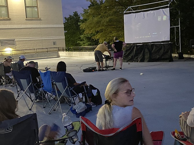 """Woodland Park Crossing hosts """"Movies Under the Stars,"""" a series of Friday evening family-friendly films."""