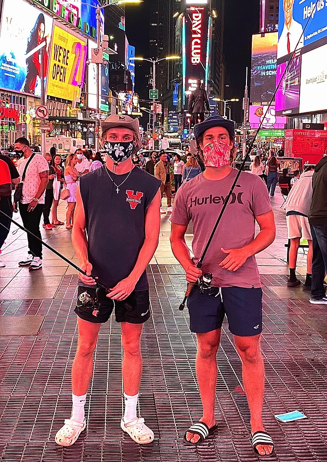 (From left) Daniel Balserak and Luke Konson in Times Square with their rods. They stopped on their way to Rhode Island.