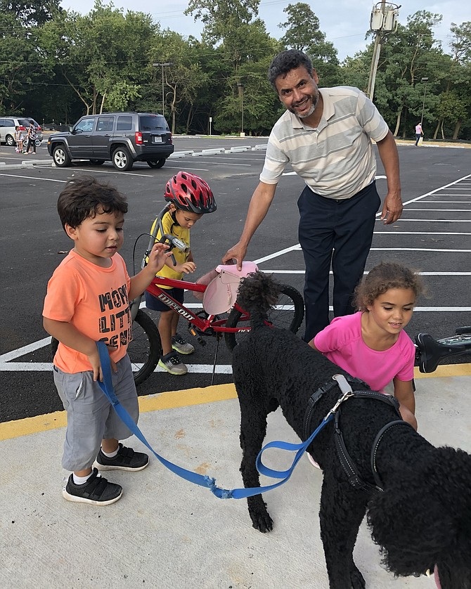 "Sometimes it is hard to tell who is having more fun at the park, the kids or the grandparents. In this case, it was a toss up.  Grandfather ""Papí"" (Elvis) Melo instructed the kids on their bikes and then took off for a victory lap around the park to enjoy the pristine blacktop for himself."