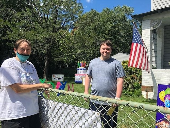 Ryan Bailey, right, celebrates his 31st birthday with Pat Miller during a surprise yard and drive-by celebration Aug. 30 in Del Ray.