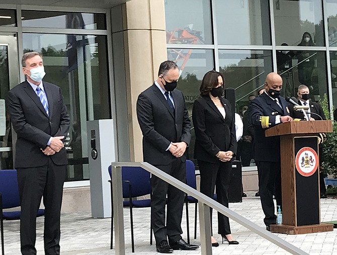 (From left) U.S. Sen. Mark Warner (D-Va.); Douglas Emhoff;  Democratic Vice Presidential candidate, U.S. Sen. Kamala Harris  (D-Calif.); and Fairfax County Fire Chief John S. Butler bow their heads in a moment of silence.