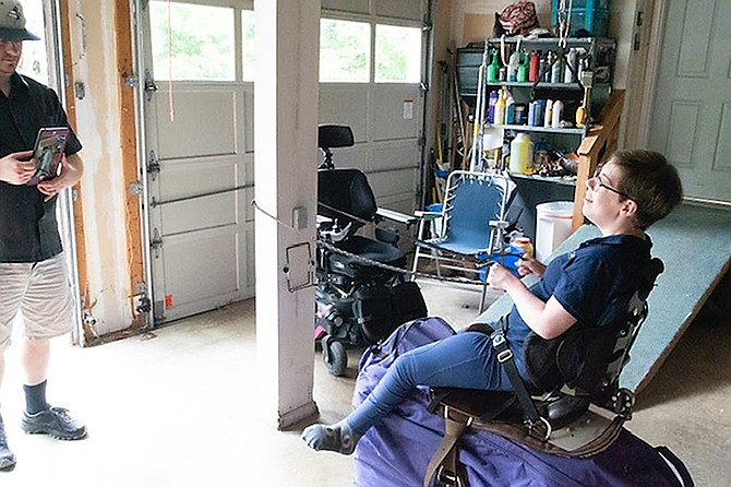 Turning possible into possibilities: Rachael Wessel on her hay horse in her garage.