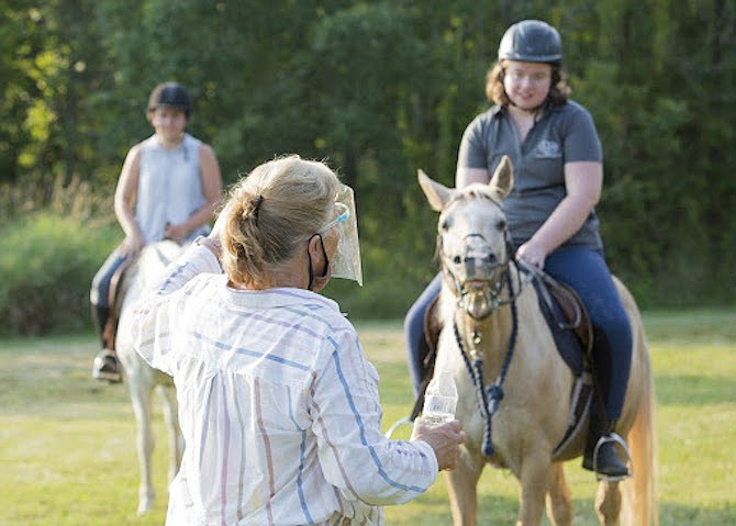 Dada Suvak of Reston instructing Nicole Springer (Sterling), during her riding lesson at Spirit Equestrian in Frying Pan Park in Herndon.  Suvak is founder and director of Spirit.