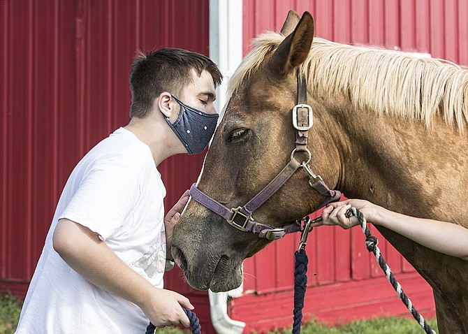 "Jimmy Kirkland reuniting with ""Monkey Business,"" or as he is inexplicably nicknamed, Pierre, at Northern Virginia Therapeutic Riding Program in Clifton."