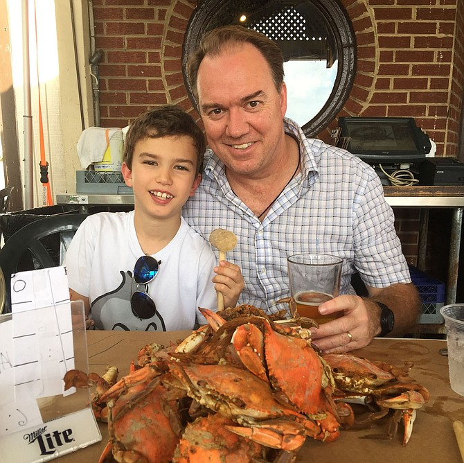 Sam and his dad back in U.S. with a pile of crabs.