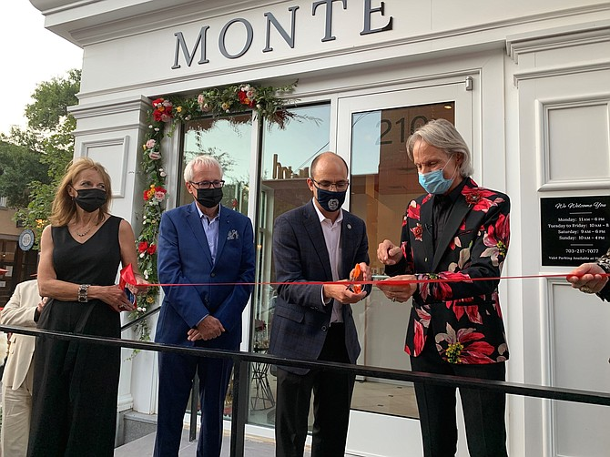 Monte Durham, right, cuts the ribbon at the grand opening of his new eponymous salon Sept. 12 in Old Town. With him are (l-r) Mickey Durham, Jack Evans and Mayor Justin Wilson.
