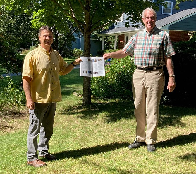 Brent Steury, left, and James (Jim) Sherald, right, socially distanced and holding the journal article that described the new soldier beetle species named in Jim's honor.
