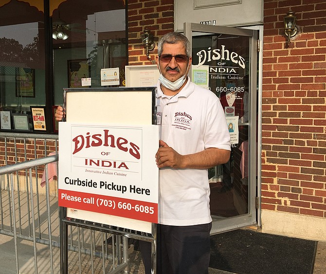 Naresh Bhatt welcomes guests to Dishes of India in Belle View. This family owned and operated restaurant is open currently for carry-out only.