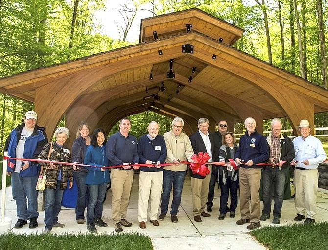 Supervisor Foust, Fairfax County Park Authority representatives, and community members celebrated the opening of the Outdoor Education Classroom/Picnic Shelter at Riverbend Park.