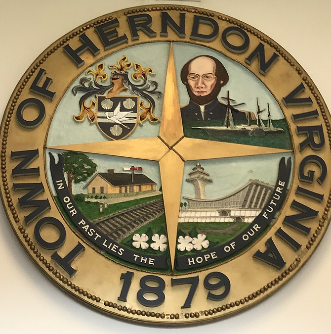 """""""In our past lies the hope for our future,"""" reads the small lettering at the bottom of  the Town of Herndon seal. The settlement was named Herndon in 1878 and incorporated in 1879. The 4.2-square-mile town is structured under the Council/Manager form of government. The Council is made up of a Mayor and six Council members elected simultaneously for two-year terms."""