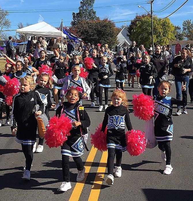 Southwestern Youth Association cheerleaders marching during last year's Centreville Day parade. This year's celebration is Oct. 17, but due to the pandemic, will be held online.