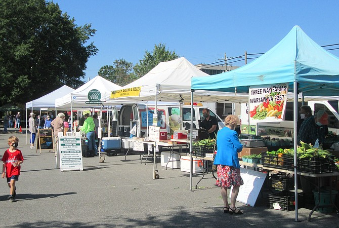 Vendors set up tents and tables every Wednesday by 8 a.m.