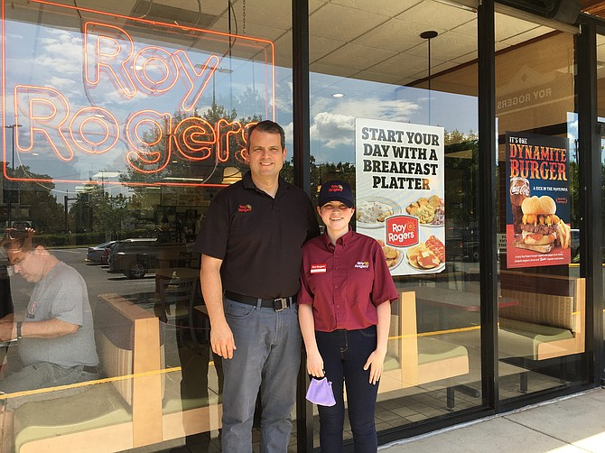 Jason Hunt and his daughter Delia welcome customers to the Manchester Lakes Roy Rogers Restaurant.