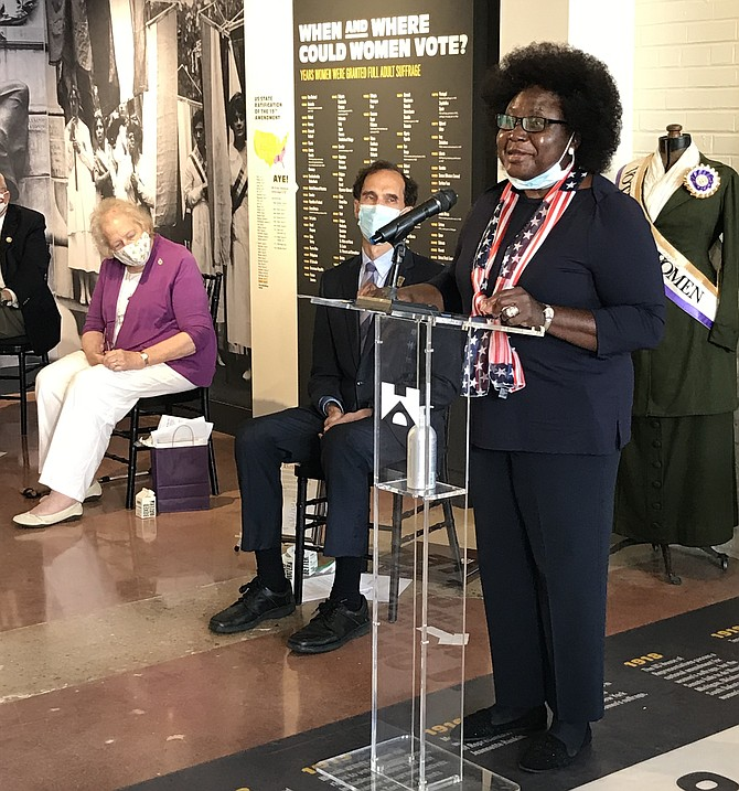 Fairfax History Commissioner Anne Barnes participating in celebration of the Year of the Woman with the 100th Anniversary of Women's Right to Vote at the Lucy Burns Museum at the Workhouse Arts Center.