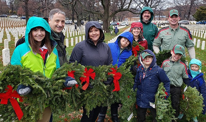 New Life's American Heritage Girls and Trail Life troop members ready to lay Christmas wreaths last year at the U.S. Soldiers' & Airmen's Home National Cemetery in Washington, D.C.
