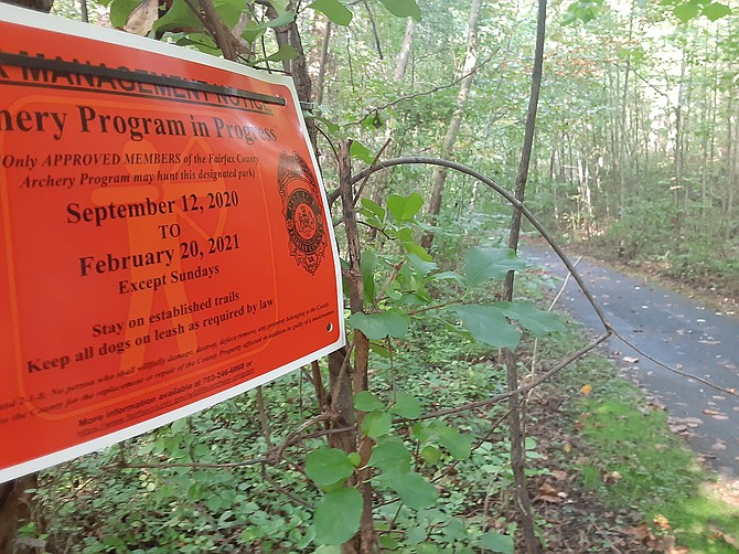 These orange signs are posted at the trailhead in places where the archery program is conducted.