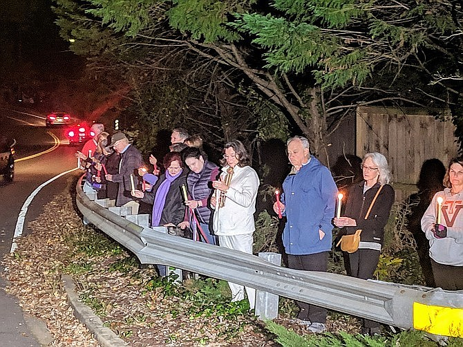 More than one hundred Mount Vernon residents joined Bijan Ghaisar's family in a candlelight vigil at the shooting site in November, 2018.