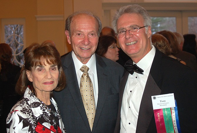 Bernard Cohen, center, with his wife Rae and law partner Tom Curcio, at the Virginia Trial Lawyers Association convention in 2014.