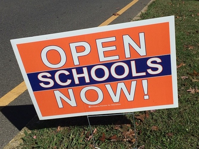 """Open School Now"" signs pop up all over Arlington."