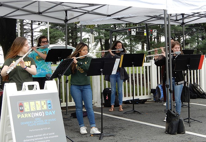 GMU flute players performing for Parking Day attendees.