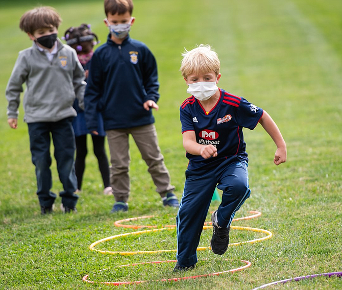 It's a race through the hoops for Bullis School Lower School students during Founders Festival Week.