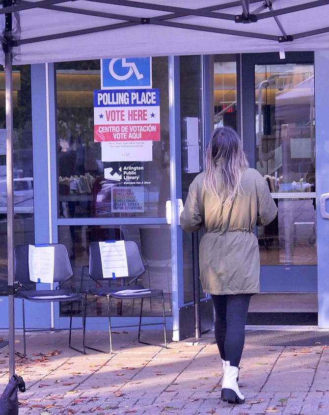 A line of Arlingtonians waited to vote at the Central Library at 6 am when the polls opened, but by 7:30, it had slowed down to a steady flow of one-to-two voters at a time.
