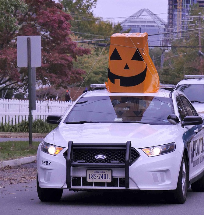Arlington County Police Department hosts a ghoulishly good time with their Halloween parade of costumed cruisers on Saturday, Oct. 31.