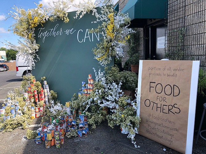 The sign outside Sweet Root Village's pop up features the charity for which it was raising money during its September event.