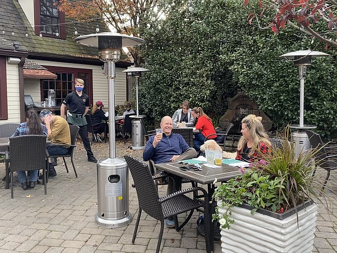 Customers return to the Old Brogue, an Irish Pub in Great Falls as temperatures head toward the high 60s on Sunday, Nov. 15. Still, with cold weather on its way, owner Mike Kearney worries about the restaurant operating below its socially distanced capacity.