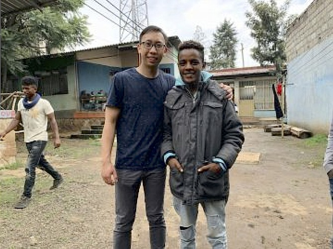 McLean filmmaker Josh Leong with a 17-year old orphan boy, Abel, whose life story inspired a short film on the Ethiopian orphan crisis, premiering online on Nov. 20.