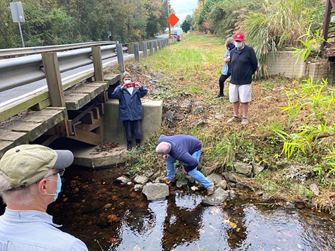 Members of the GFCA Bridge Working Group inspect the Springvale Road Bridge recently, as GFCA President Bill Canis (foreground) looks on.