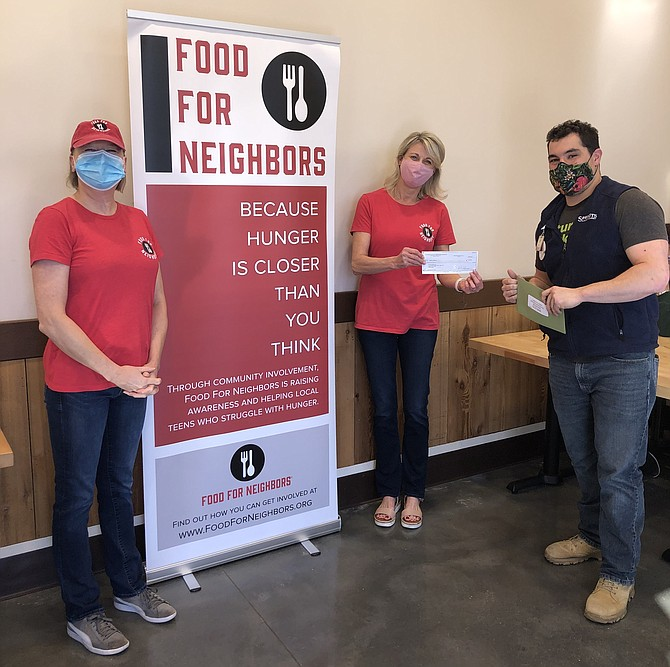Bryan Daniell (right), Assistant Manager of Sprouts Farmers Market in Herndon, presents Food For Neighbors volunteers Romy Nathan (middle) and Renee Maxwell (left) with $5,000 to support Food For Neighbors in its grassroots effort to end child hunger.