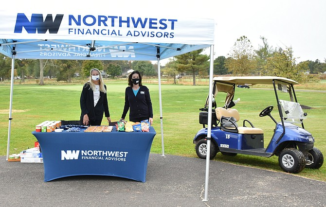 A refreshment table available to golfers, courtesy of Bronze Sponsor Northwest Financial Advisors.