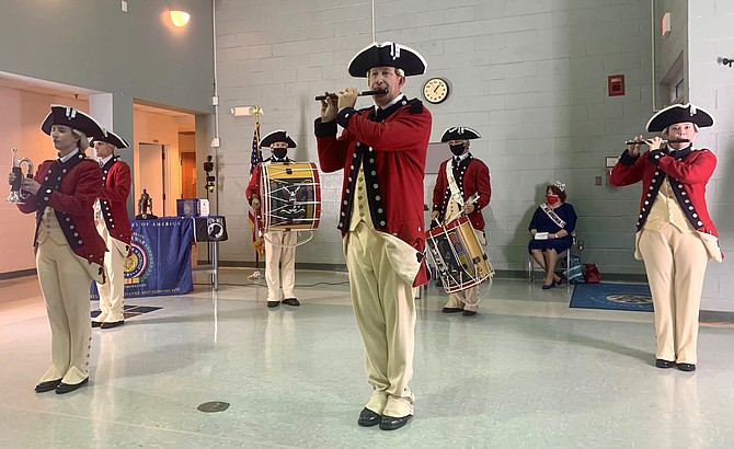 The Historical Trumpets and Flutes of the United States Army Old Guard Fife and Drum Corps perform a musical interlude for the attendees of the Veterans Day program Nov. 11 at Blessed Sacrament School Hall.