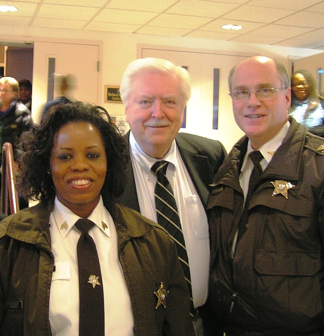 Harry Covert, center, with Sheriff's Office Chief Deputy Candra Callicott and then-Undersheriff Tony Davis at a Martin Luther King Jr. Day ceremony.
