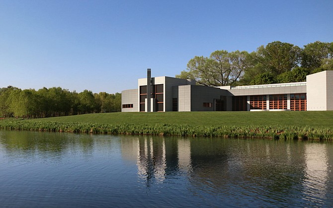 The Gallery hosts changing exhibitions in generously proportioned spaces and opens up to a terrace overlooking a pond. A limited palette of materials—zinc, granite, stainless steel, and teak—allows the architecture to exist in harmony with the surrounding landscape and the art it houses.