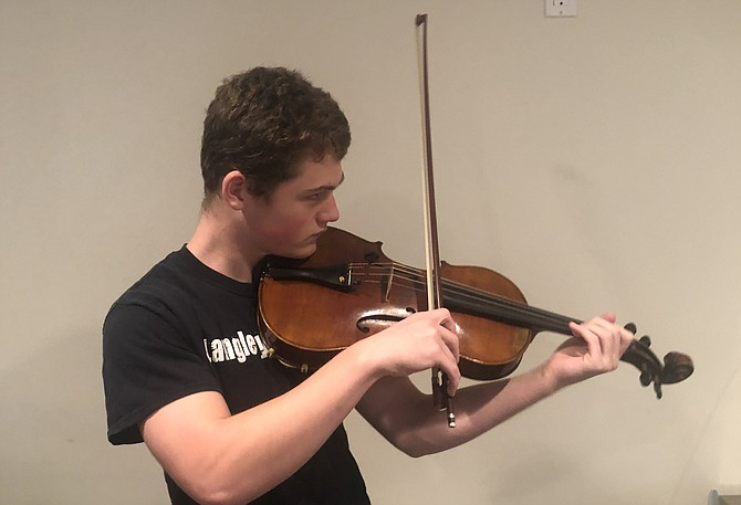 Senior Otto Janke plays viola in a video recording that is included in the Langley HS Orchestra's virtual concert.