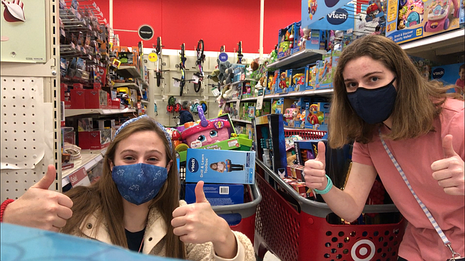 Anna Bartlett (left) and Lauren Rosenthal, Yorktown High School students, on a buying spree at Target for children at Doorways.