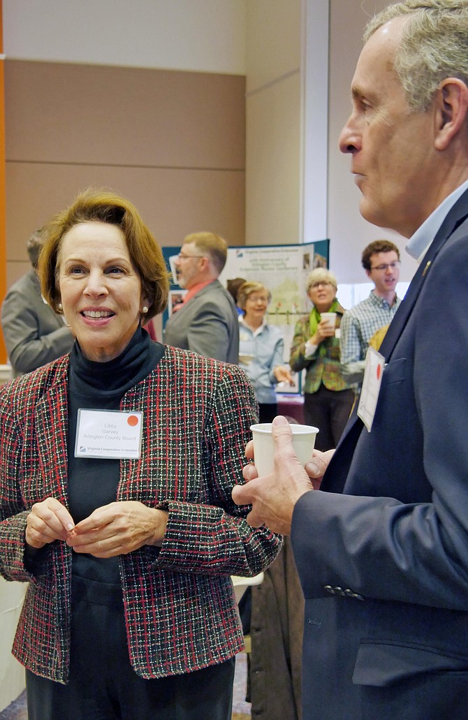 Mark Jinks, Alexandria City Manager, chats with Arlington County Board Chair, Libby Garvey, before the 2019 Virginia Cooperative Extension breakfast where Jinks showed off his 4-H T-shirt. Kids in his family started 4-H at seven years old, where he and his brother got cows, ponies and had a Christmas tree farm. Jinks' father went on to become 4-H Director of the State of Pennsylvania.