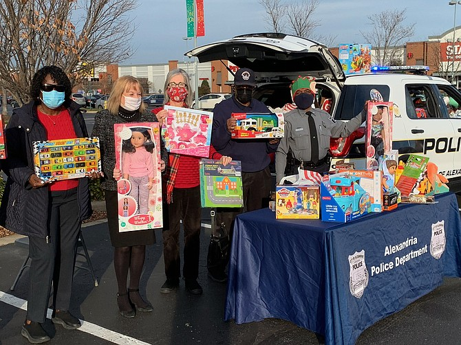The Commonwealth Republican Women's Club supported the Alexandria Police Department's toy drive. Supporters included, left to right: Ruth Cleveland, Suzanne Morrison, Linda App, Bill Cleveland and Officer Bennie Evans.