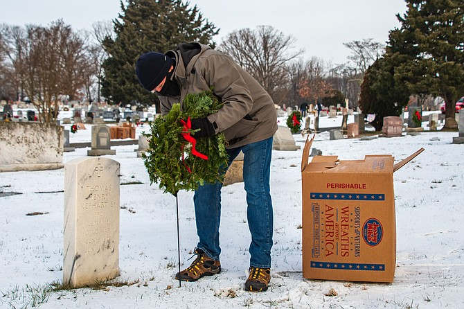 A remembrance wreath is placed at the gravesite of Private First Class United States Army World War II veteran Thomas Henry Kephart Sr. on Wreaths Across America Day, Dec. 19, 2020, at Chestnut Grove Cemetery in Herndon.