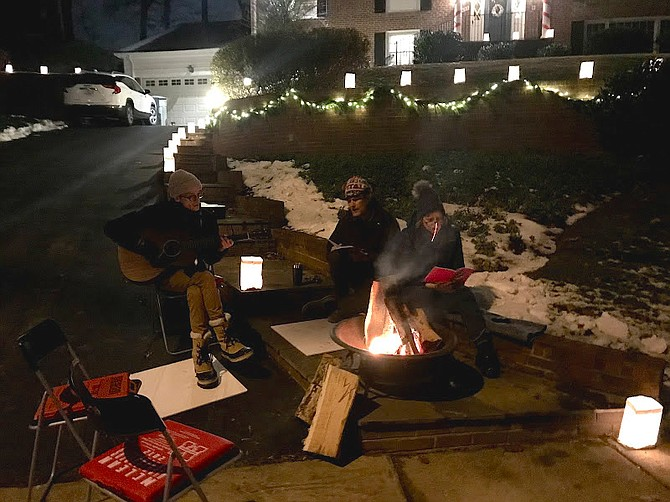 The musical Juneau family played Carols by their bonfire.