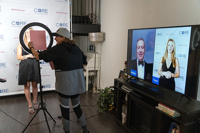 (From left) In a herculean effort for CORE Foundation, fueled by everyone pitching in, Taralyn Tharp Kohler, Executive Director, Jackie Kido, cameraman, Doug Bushée, founder and Chairman (on-screen) and Tharp Kohler (on-screen) go live and virtual for the organization's 15th-anniversary event.