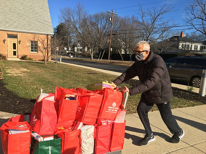 Frank Wagner, a volunteer from Reston, braved the cold to collect donations that will later be packaged and distributed to middle and high school students in Herndon.  Other collection sites in Fairfax and Loudoun counties were also busy, as Food For Neighbors received more than 18,000 pounds of food to support students in 22 schools.