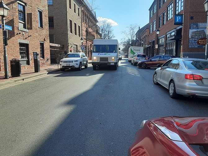 This FedEx truck in Old Town Alexandria is not only blocking the street in both directions, but also the side street that feeds into it.