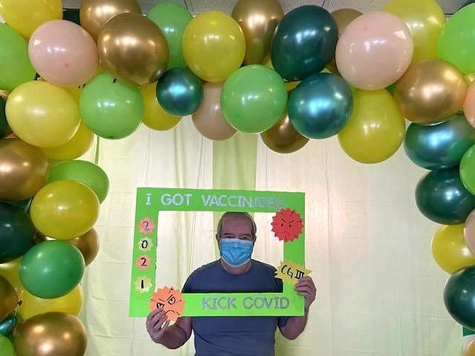 Culpepper Garden resident in assisted living celebrates the receiving coronavirus vaccine on Jan. 27.