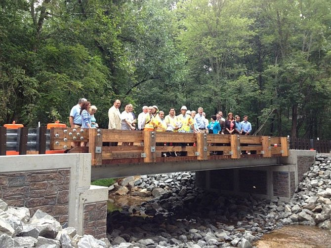 It could be déjà vu back to 2013 for the Springvale Road Bridge. Then, neighbors, elected officials and VDOT staff stood on the new single-lane rural rustic Beach Mill Road Bridge over Nicholas Branch in Great Falls.