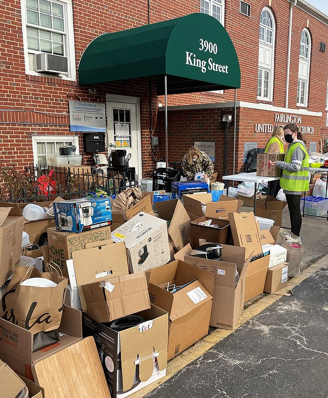 A volunteer looks over boxes of donated goods during the Alive! housewares donation day Feb. 6 at Fairlington United Methodist Church.